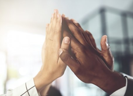 Image of people high-fiving