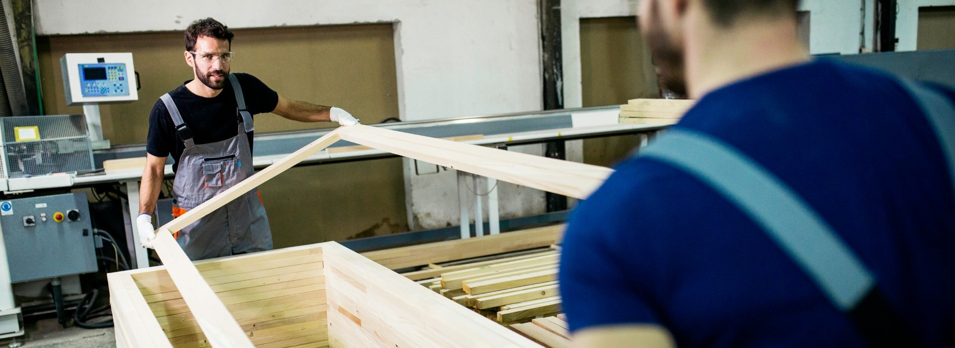 Image of carpenters with wooden frame